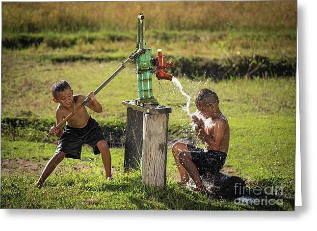 Greeting Card featuring the photograph Two Young Boy Rocking Groundwater Bathe In The Hot Days. by Tosporn Preede