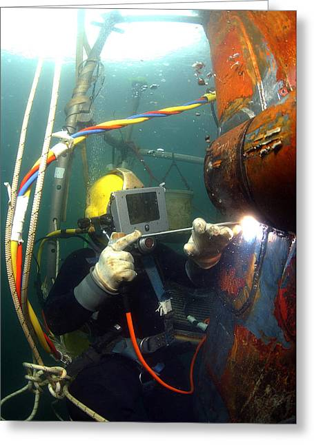 Swimsuit Photography Greeting Cards - U.s. Navy Diver Welds A Repair Patch Greeting Card by Stocktrek Images