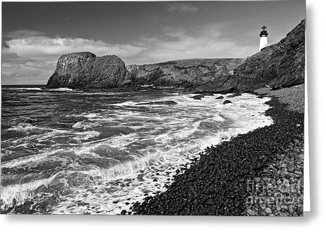Yaquina Lighthouse On Top Of Rocky Beach Greeting Card