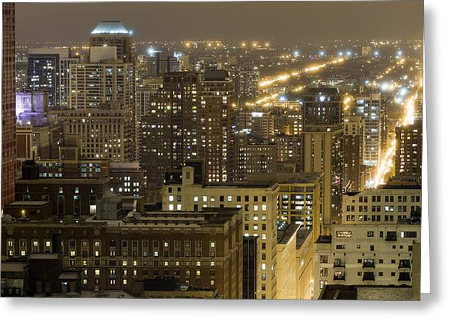 Buildings In A City Lit Up At Night Greeting Card by Panoramic Images