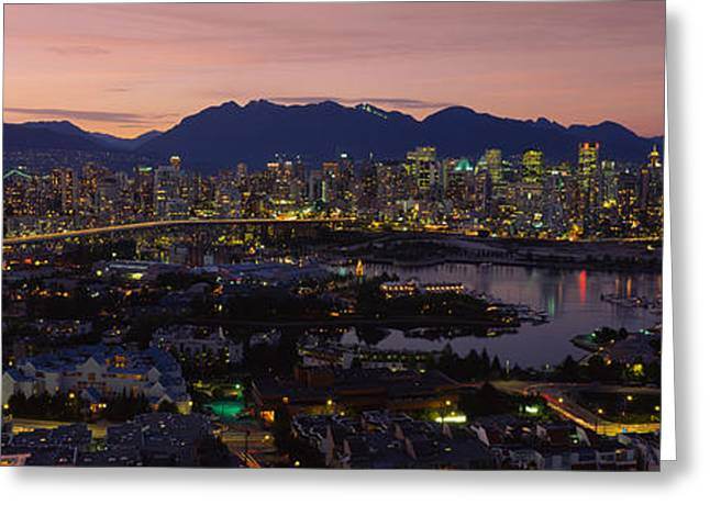 Aerial View Of A City Lit Up At Dusk Greeting Card