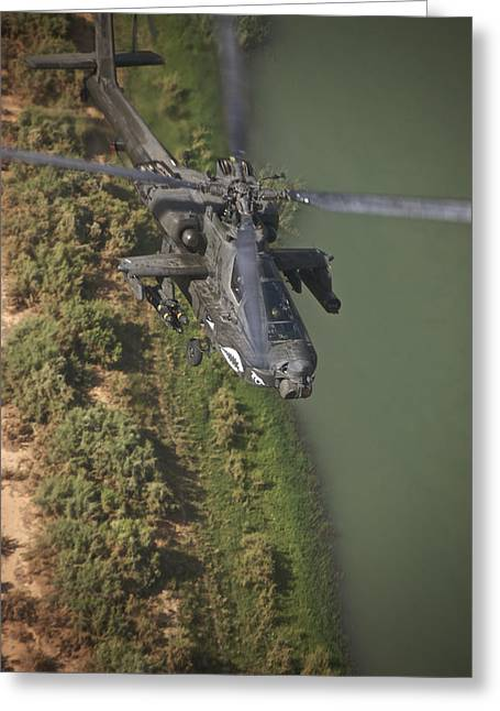Iraq Greeting Cards - An Ah-64d Apache Helicopter In Flight Greeting Card by Terry Moore