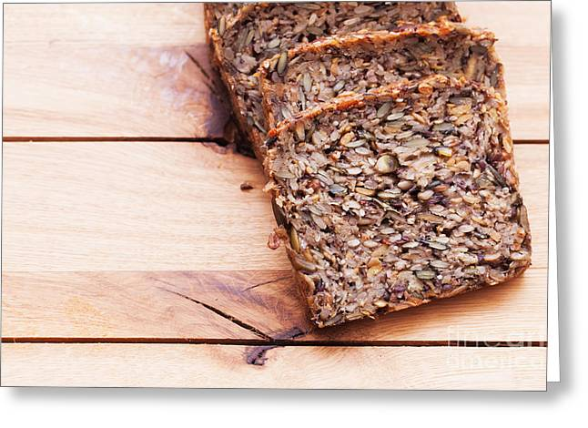 Wholemeal Bread On Wooden Table Greeting Card by Michal Bednarek