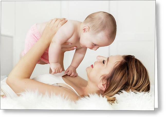 Mother With Her Newborn Baby Daughter. Candid Emotions Of Maternity Love. Greeting Card by Michal Bednarek
