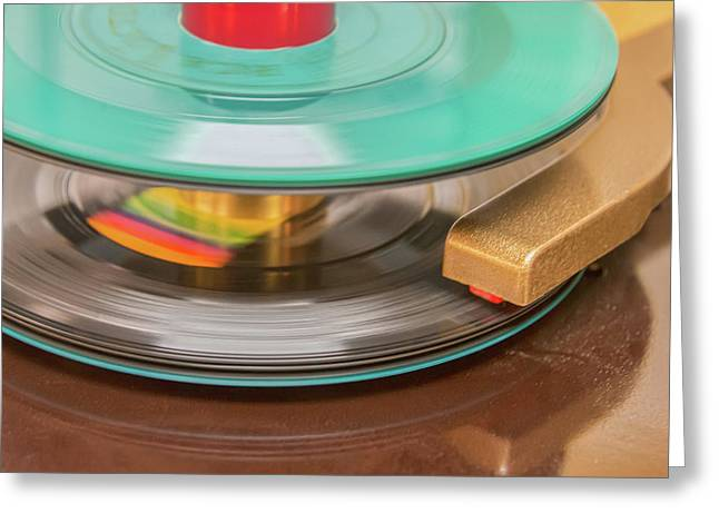 Greeting Card featuring the photograph 45 Rpm Record In Play Mode by Gary Slawsky