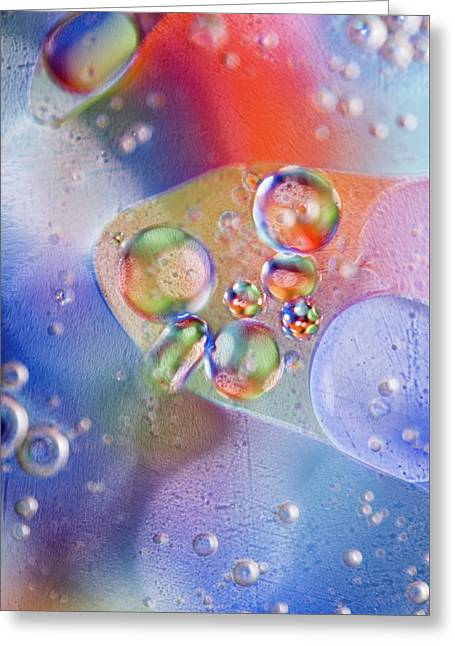 Greeting Card featuring the photograph Oil In Water by Kevin Blackburn