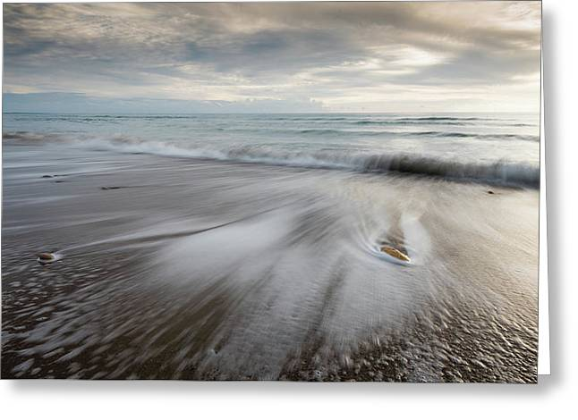 Greeting Card featuring the photograph Pebbles In The Beach And Flowing Sea Water by Michalakis Ppalis