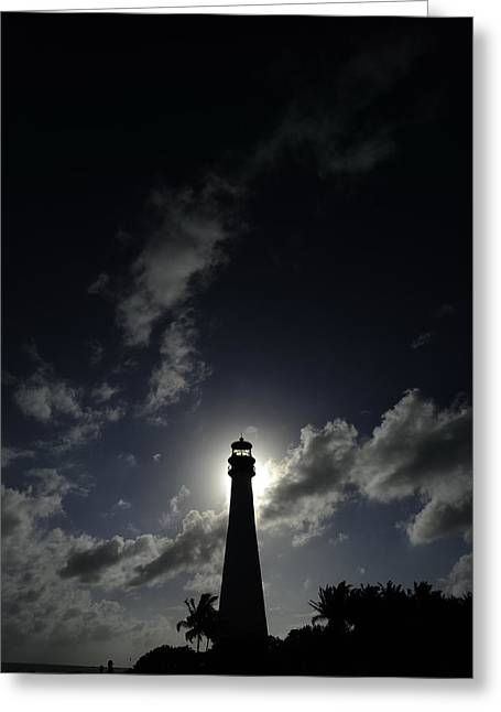 A Backlit View Of A Lighthouse Built Greeting Card by Raul Touzon