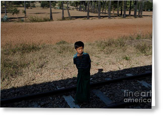 A Boy In Burma Looks Towards A Train From The Shadows Greeting Card by Jason Rosette