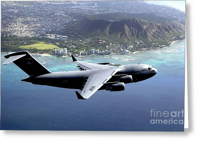 Freight Aircraft Greeting Cards - A C-17 Globemaster Iii Flies Greeting Card by Stocktrek Images