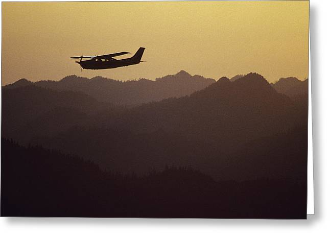 Timberline Greeting Cards - A Cessna 210 Soars Above Olympic Greeting Card by Joel Sartore