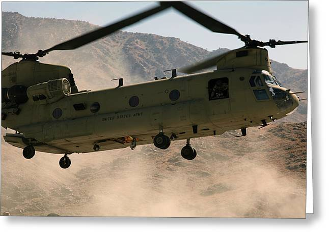 Hovering Greeting Cards - A Ch-47 Chinook Helicopter Kicks Greeting Card by Stocktrek Images