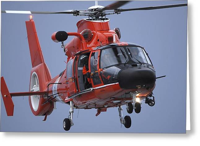 Rotorcraft Photographs Greeting Cards - A Coast Guard Mh-65 Dolphin Helicopter Greeting Card by Stocktrek Images