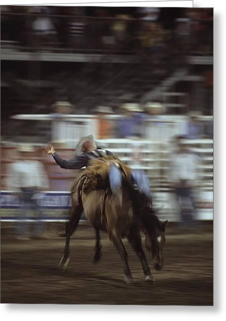 A Cowboy Rides A Bucking Bronco Greeting Card