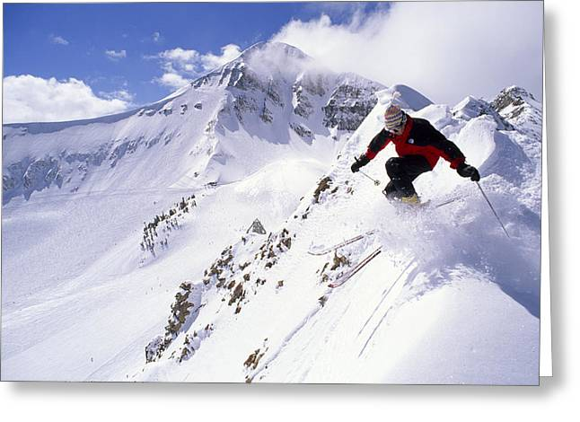 Image Setting Greeting Cards - A Downhill Skier Launching Greeting Card by Gordon Wiltsie