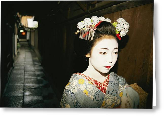 A Geisha In Traditional Costume Walks Greeting Card
