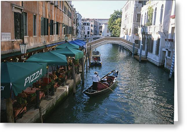 Tourists And Tourism Greeting Cards - A Gondolier Passes A Restaurant Greeting Card by Taylor S. Kennedy