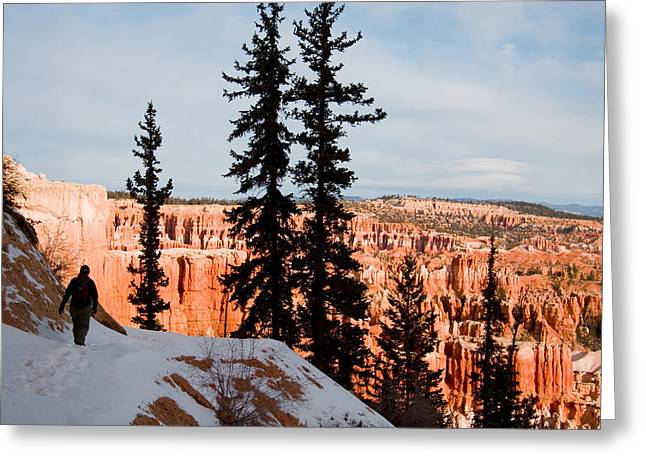 A Hiker Walks Along A Ledge In Winter Greeting Card by Taylor S. Kennedy