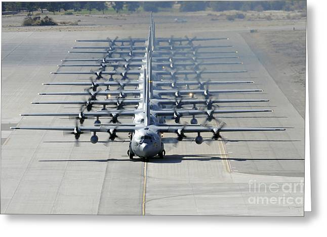 A Line Of C-130 Hercules Taxi At Nellis Greeting Card by Stocktrek Images