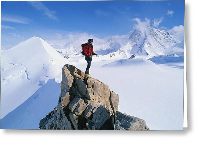 Release Greeting Cards - A Mountain Climber Summits Mount Greeting Card by Gordon Wiltsie