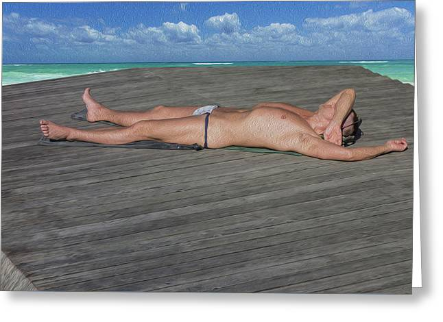 A Naked Man Is Sunbathing On The Beach. Greeting Card