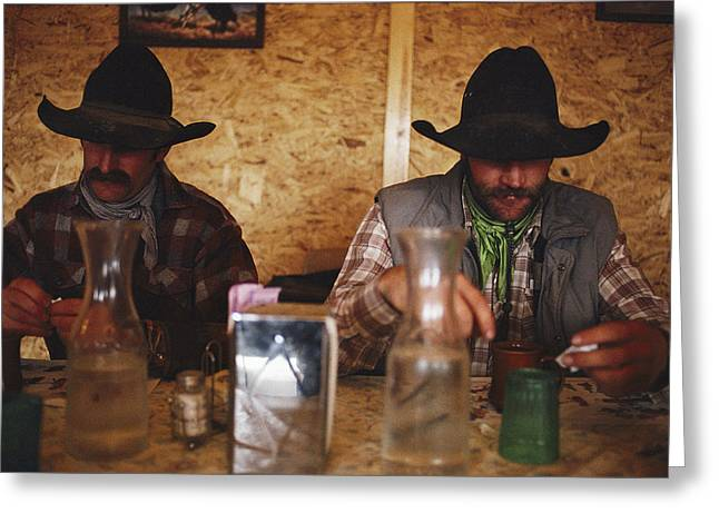 A Pair Of Cowboys Enjoy A Cup Of Coffee Greeting Card