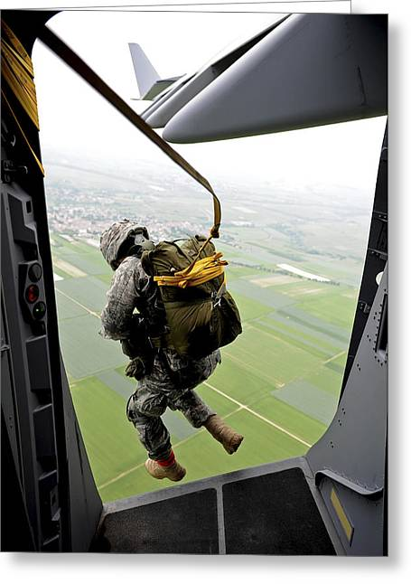 Globemaster Greeting Cards - A Paratrooper Executes An Airborne Jump Greeting Card by Stocktrek Images