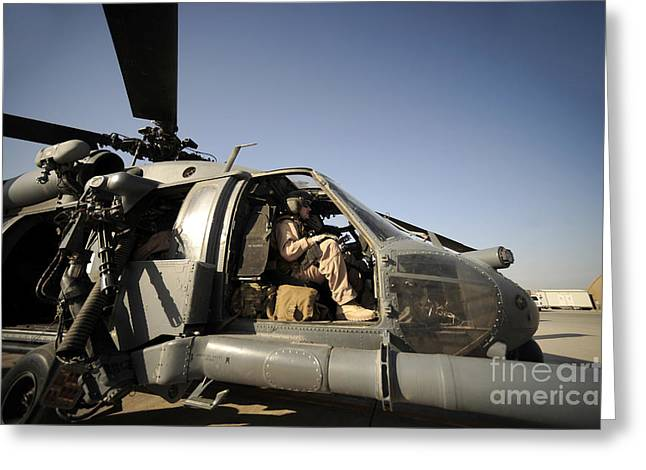 A Pilot Sits In The Cockpit Of A Hh-60g Greeting Card