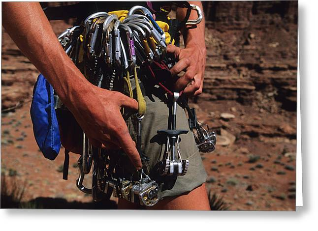 A Rock Climber Check Her Gear Greeting Card by Bill Hatcher