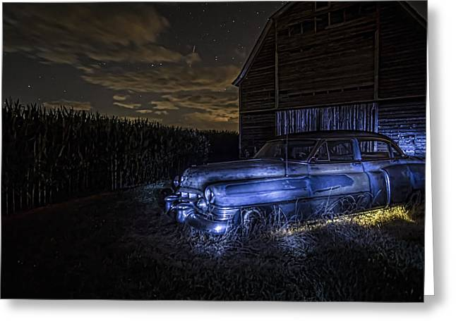 A Rusty 50's Cadillac In Painted Blue And Yellow Light One Starry Night Greeting Card by Sven Brogren