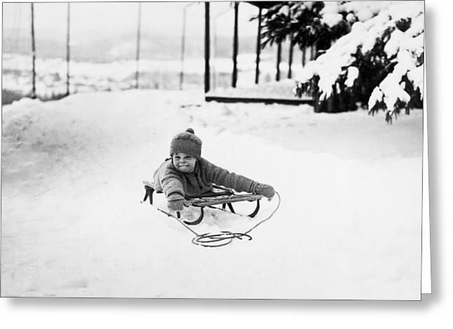 A Small Child On A Sled  Greeting Card