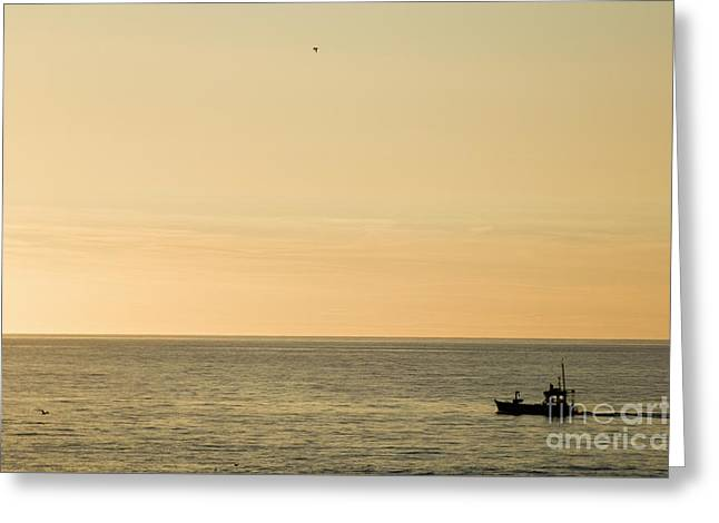 A Small Fishing Boat In Sunset Over Cardigan Bay Aberystwyth Ceredigion West Wales Greeting Card