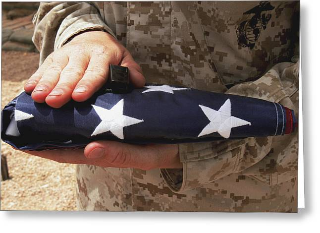 Gathering Greeting Cards - A Soldier Holds The United States Flag Greeting Card by Stocktrek Images