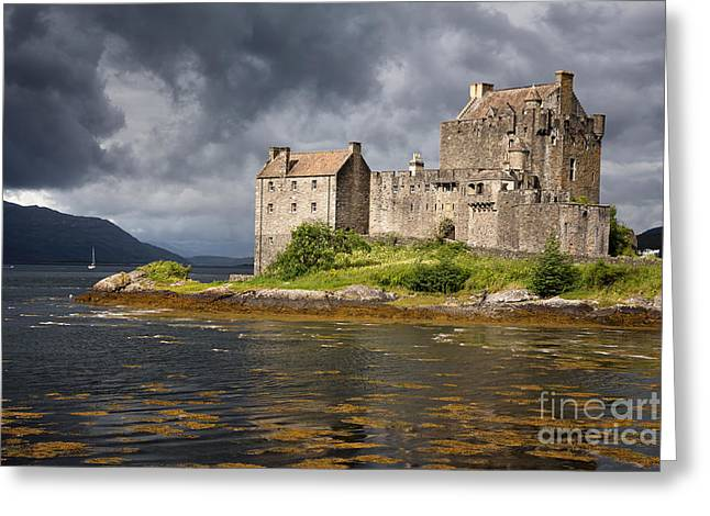 A Storm Brews Over Eilean Donan Castle Greeting Card by Jane Rix