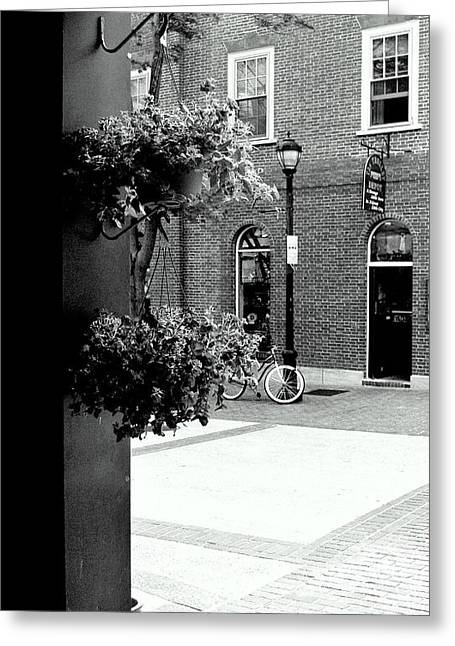 Greeting Card featuring the photograph A Stroll Through Town Square by Laura DAddona