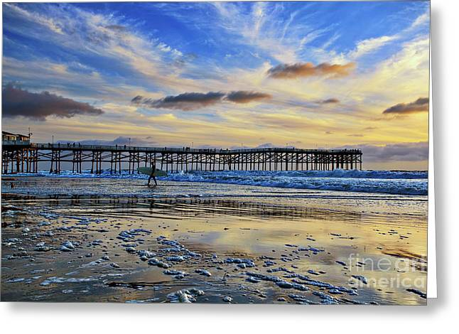 A Surfer Heads Home Under A Cloudy Sunset At Crystal Pier Greeting Card