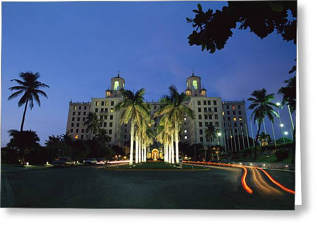 A Twilight View Of Building With Palm Greeting Card