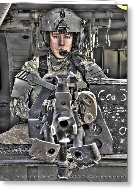 A Uh-60 Black Hawk Door Gunner Manning Greeting Card by Terry Moore