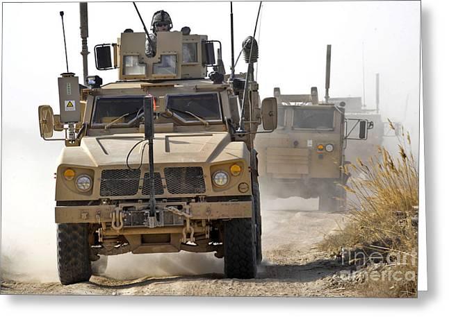 A U.s. Army M-atv Leads A Convoy Greeting Card