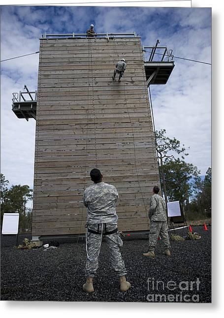 A U.s. Soldier Rappels Down A 40-foot Greeting Card
