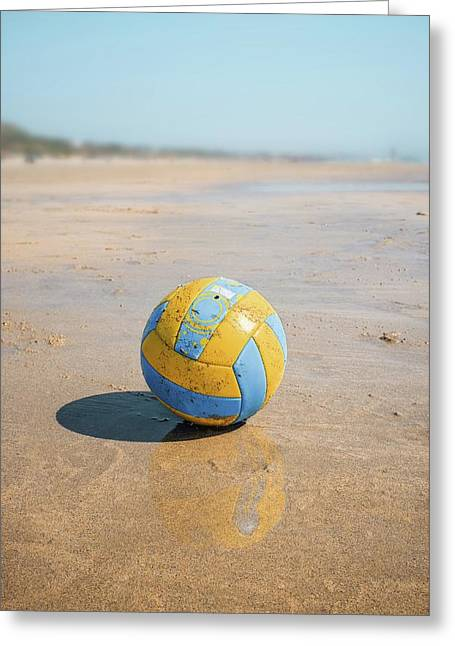 A Volleyball On The Beach Greeting Card by Carlos Caetano