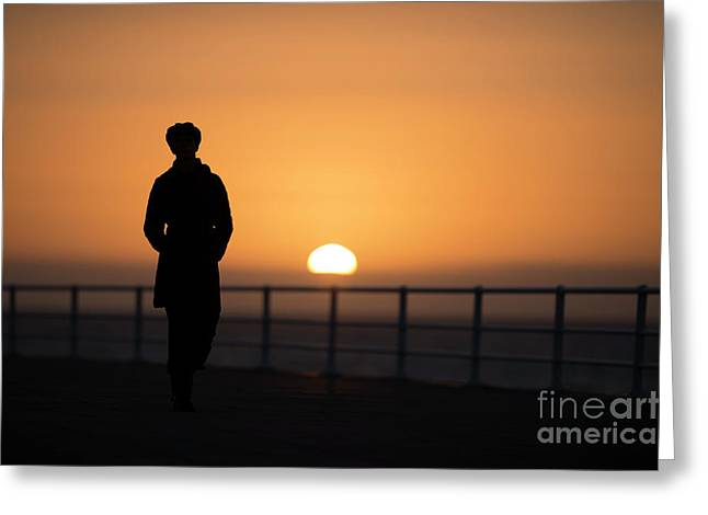 A Woman Silhouetted At Sunset Greeting Card