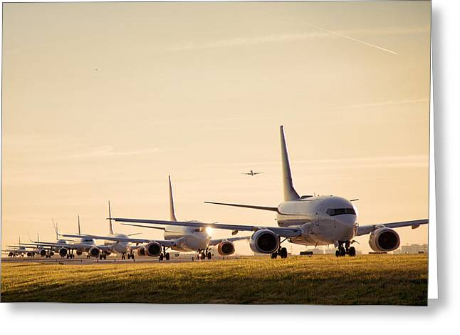 Airplanes Lining Up For Take-off Greeting Card by Raymond Persaud