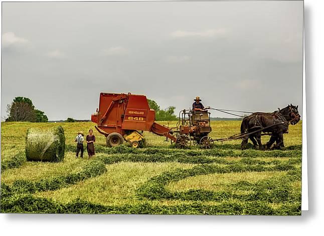 Amish Family In Hayfield  Greeting Card by Vladimir Kudinov