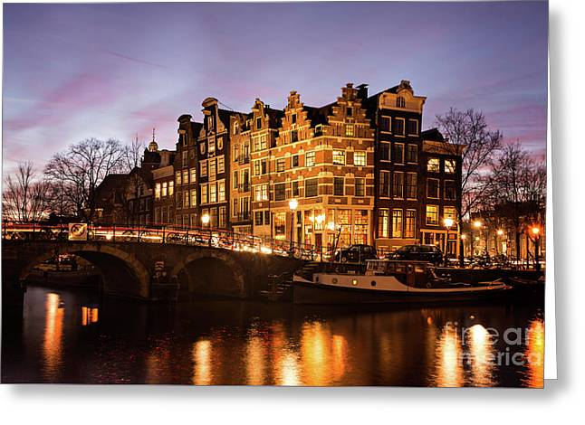 Greeting Card featuring the photograph Amsterdam Canal Houses With Reflection At Dusk by IPics Photography