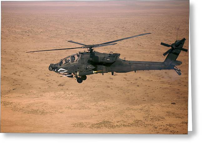 Iraq Greeting Cards - An Ah-64d Apache Longbow Fires A Hydra Greeting Card by Terry Moore