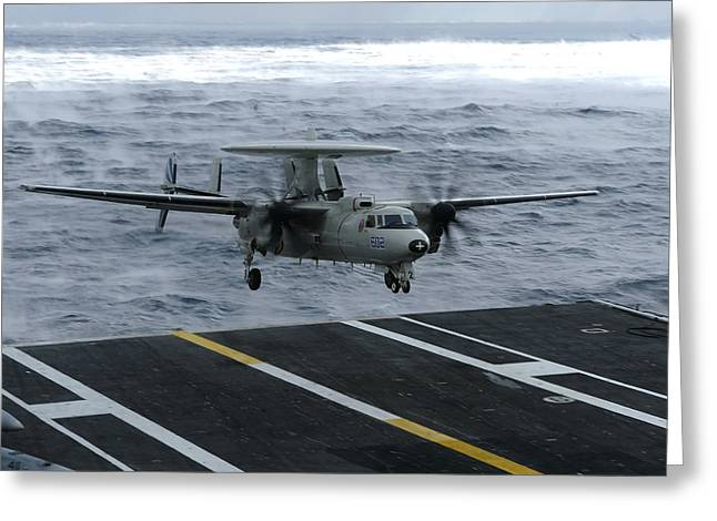 Aircraft Carrier Greeting Cards - An E-2c Hawkeye Lands Aboard Greeting Card by Stocktrek Images