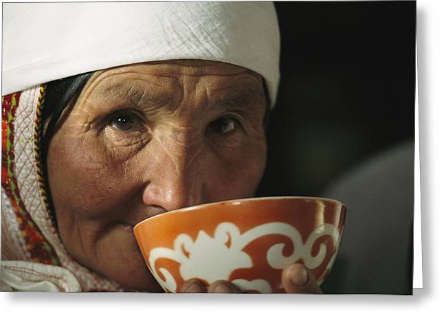 An Elderly Woman Drinks From A Cup Greeting Card by David Edwards