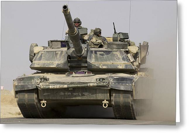 Driving Machine Greeting Cards - An M1a1 Abrams Tank Heading Greeting Card by Stocktrek Images