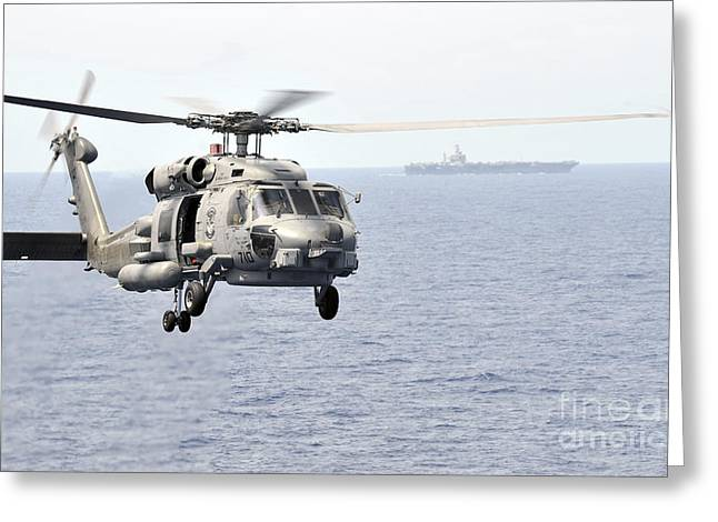 An Mh-60r Seahawk Helicopter In Flight Greeting Card by Stocktrek Images